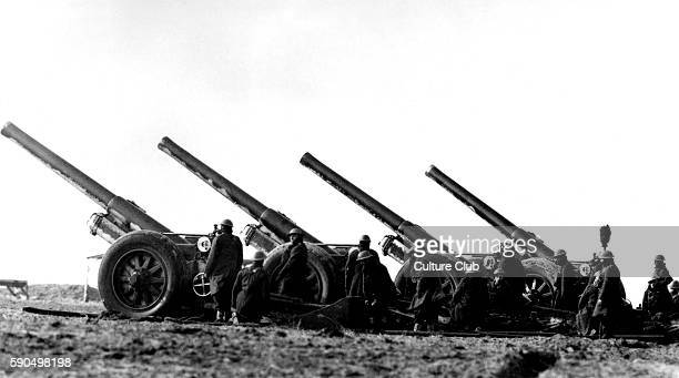 Field guns. Caption reads: ' Some of the big guns of the B.E.F as they took part in a demonstration in France. ' Official War Office photograph.