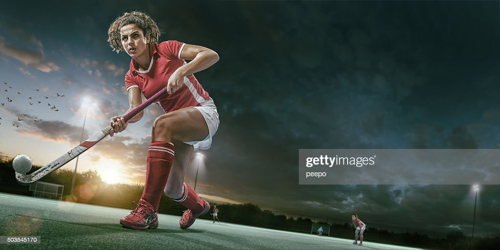 Field Hockey Player In Mid Action During Hockey Game Stock ...