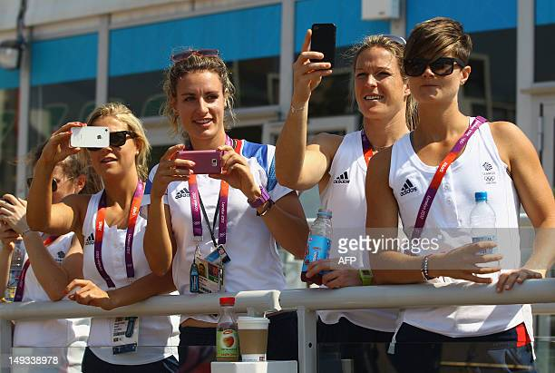 Field hockey players Georgie Twigg, Ashleigh Ball, Crista Cullen and Sally Walton of Great Britain look on during the Olympic Village arrivals ahead...