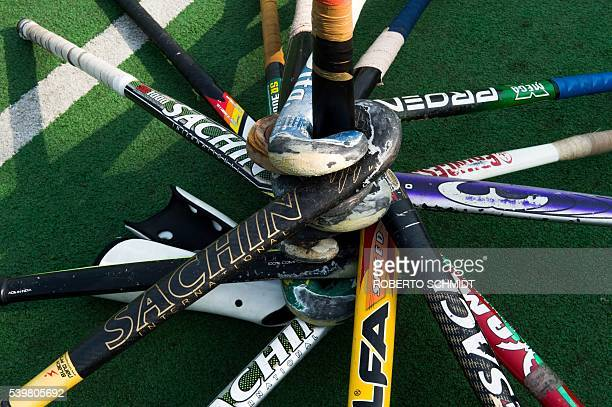 Field Hockey sticks are stacked on the side of a hockey field prior to an afternoon practice session by Indian children at the grounds of the Major...