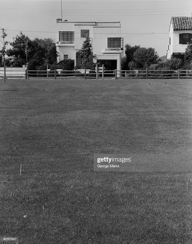Field in front of house : Stock Photo