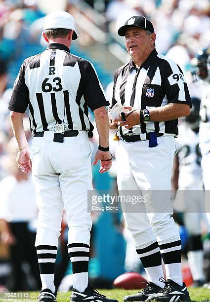 Field judge Bill Lovett talks with referee Bill Carollo as the the Jacksonville Jaguars take on the Tennessee Titans at Alltel Stadium on September 9...