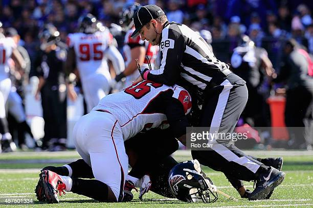 Field Judge Brad Freeman breaks up an altercation between strong safety Kemal Ishmael of the Atlanta Falcons and wide receiver Steve Smith of the...