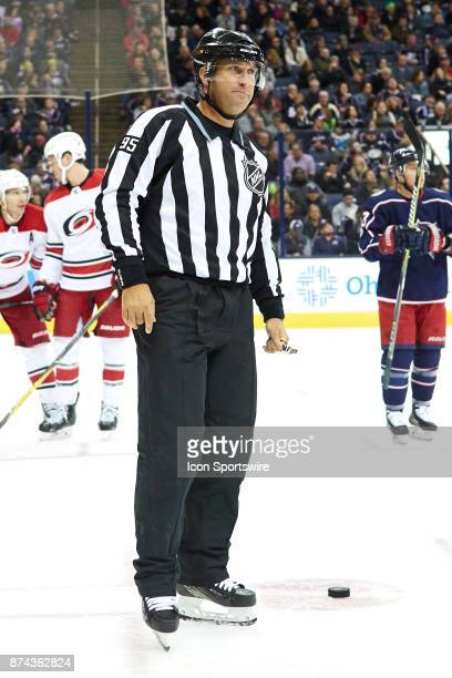 Field judge James Coleman looks on during a game between the Columbus Blue Jackets and the Caroling Hurricanes on November 10 at Nationwide Arena in...