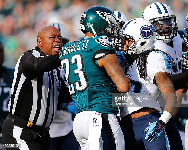 Field Judge Terry Brown attempts to separate Nolan Carroll of the Philadelphia Eagles and Dexter McCluster of the Tennessee Titans in the second...