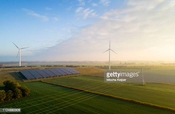 field landscape with wind turbines and solar farm located on former waste dump, elevated view, netherlands - dutch culture stock pictures, royalty-free photos & images