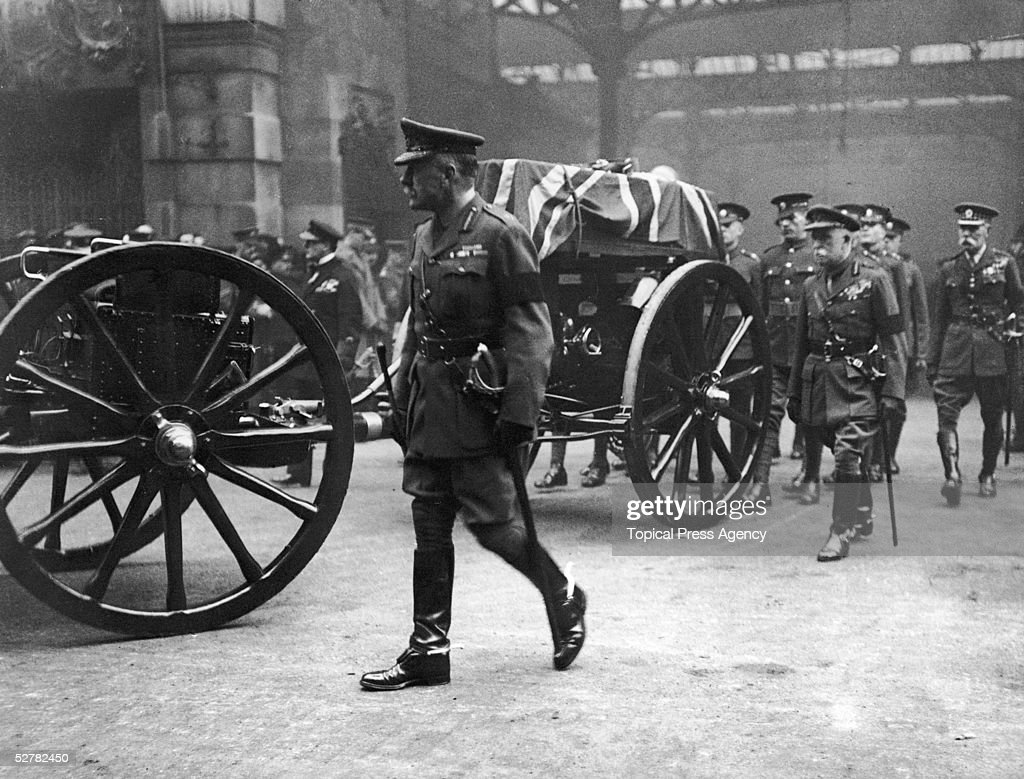 Field Marshal Douglas Haig (1861 - 1928) and Field Marshall John French, first Earl of Ypres (1852 - 1925) beside the coffin of the unknown warrior as it is carried in procession from Victoria Station to its final resting place at the Cenotaph in Whitehall, 11th November 1920.