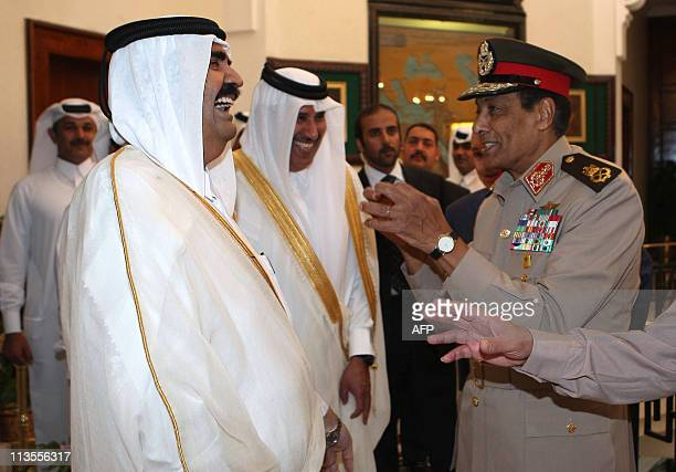 Field Marshal Hussein Tantawi head of the Supreme Council of the Armed Forces in Egypt speaks with Qatari Emir Hamad bin Khalifa alThani in Cairo on...