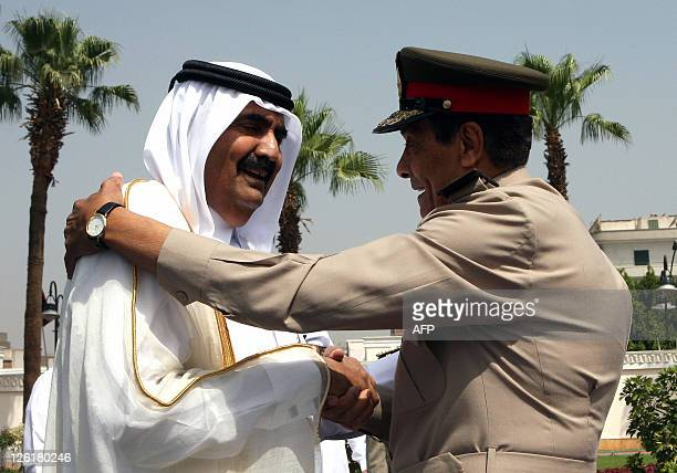 Field Marshal Hussein Tantawi head of the Supreme Council of the Armed Forces in Egypt welcomes Qatari Emir Hamad bin Khalifa alThani in Cairo on May...