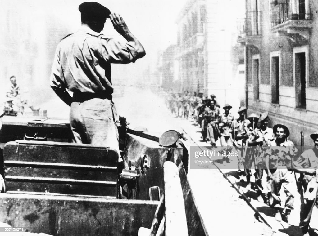 Field Marshal Montgomery saluting from his car, as he drives past troops in Reggio Calabria, Italy, September 3rd 1943.