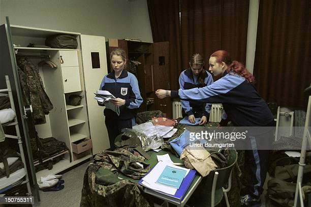 Field marshal Rommel barracks/4 company armoured infantryman battalion 212 Our picture shows female recruits putting their things into their lockers