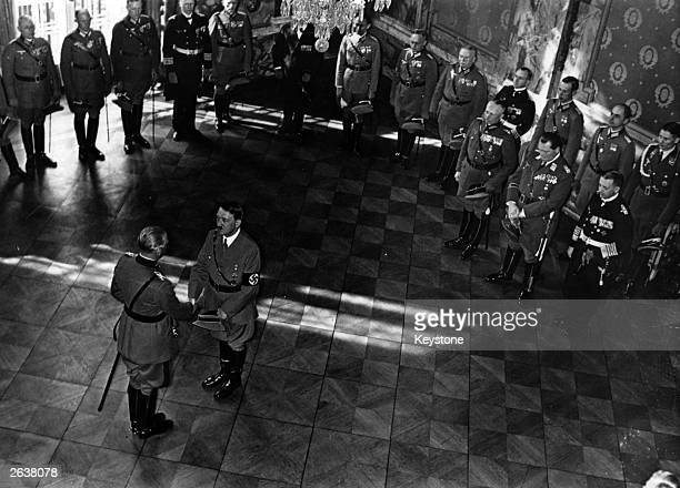 Field Marshal Werner von Blomberg celebrates forty years in the German Army as he is congratulated by Adolf Hitler General Goering Admiral Erich...