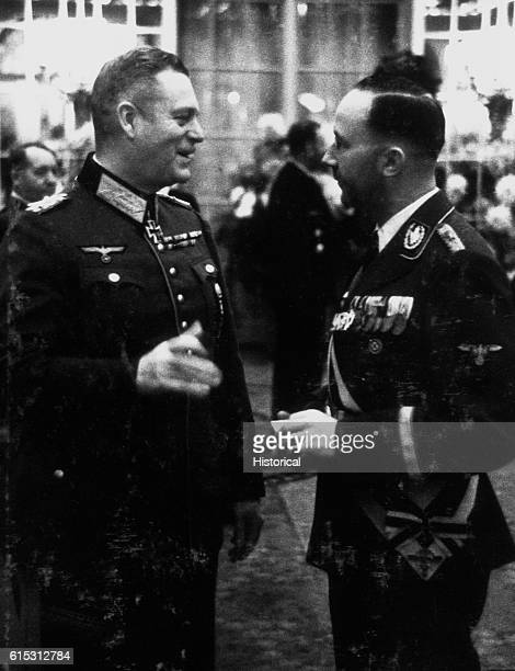 Field Marshal Wilhelm Keitel chief of the Oberkommando der Wehrmacht the German armed forces high command and Heinrich Himmler chief of the SS ca...