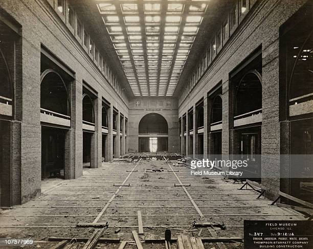 Field Museum construction site interior view of the partially completed main hall shows first and second floor with steel arches and bricks Graham...
