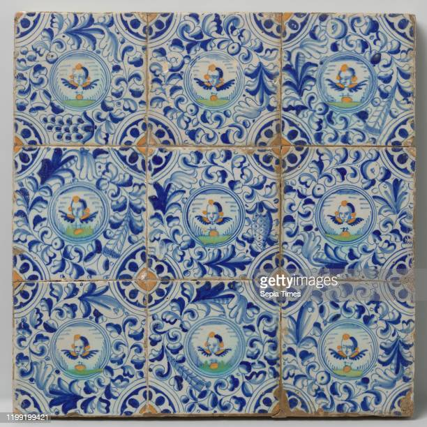 Field of nine tiles with angel heads Field of nine tiles each with a multicolored cherub head in a circle surrounded by oak leaves In the corners a...