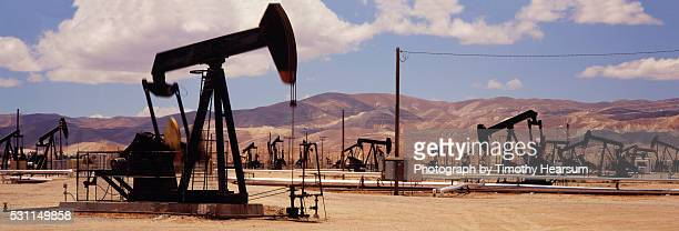 field of oil drillers - timothy hearsum stock pictures, royalty-free photos & images