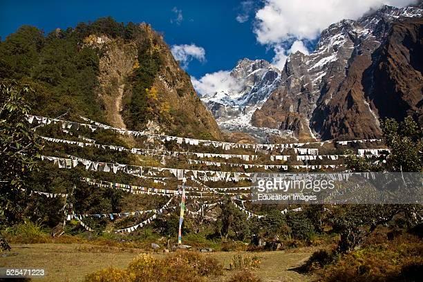 Field Of Prayer Flag Below Peaks At A Remote Tibetan Buddhist Monastery, Nepal Himalaya.