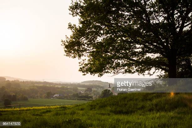 Field of rape is pictured in front of a village with a church on April 29, 2018 in Kunnersdorf, Germany.