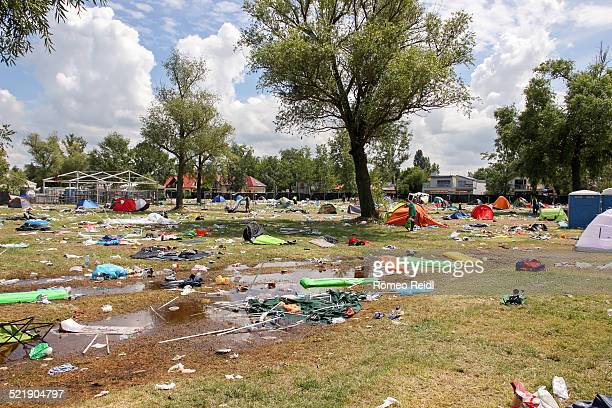 field of rubbish after a music festival - after party mess stock pictures, royalty-free photos & images