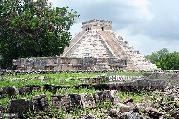 field of skulls near the pyramid at chichen itza - aztec civilization stock photos and pictures