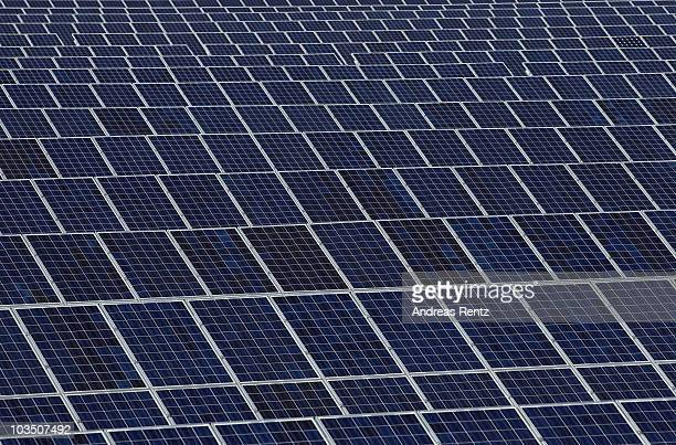 A field of solar cell panels are pictured on August 20 2010 in Roedgen near Bitterfeld Germany Germany is investing heavily in renewable energy...