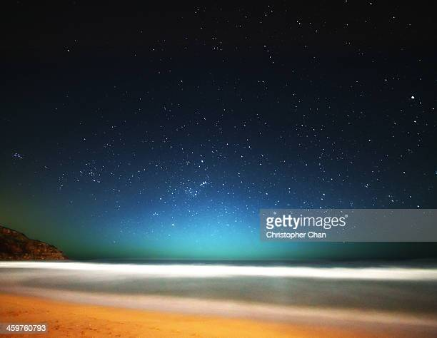 Field of stars over beach at night