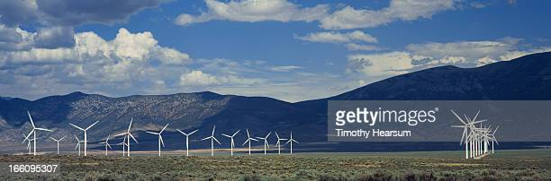 field of wind generators with mountains and sky - timothy hearsum stock pictures, royalty-free photos & images