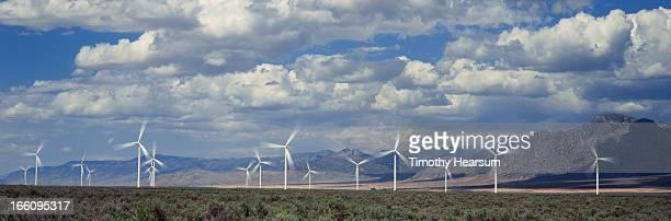 field of wind generators with mountains and sky - timothy hearsum stockfoto's en -beelden