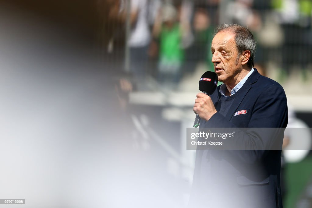 Field reporter Rolf Fuhrmann of sky is seen prior to the Bundesliga match between Borussia Moenchengladbach and FC Augsburg at Borussia-Park on May 6, 2017 in Moenchengladbach, Germany.