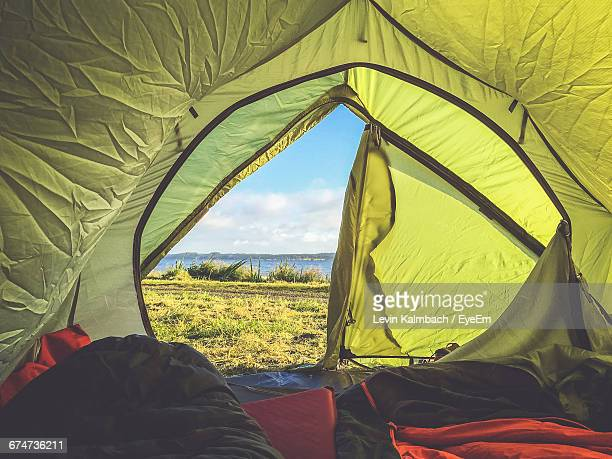 field seen through tent - tent stock pictures, royalty-free photos & images