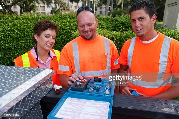 field technicians and supervisor testing water - ph value stock pictures, royalty-free photos & images
