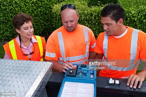 Field Technicians and Supervisor Testing Water