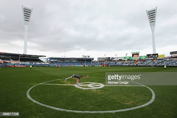 A field umpire bouncers the ball in his warm up during the round 23 AFL match between the Geelong Cats and the Adelaide Crows at Simonds Stadium on...