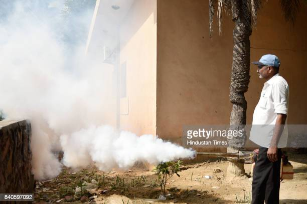Field worker fumigates in Okhla Shaheen Bagh, on August 29, 2017 in New Delhi, India. As per the report released by three municipal corporations of...