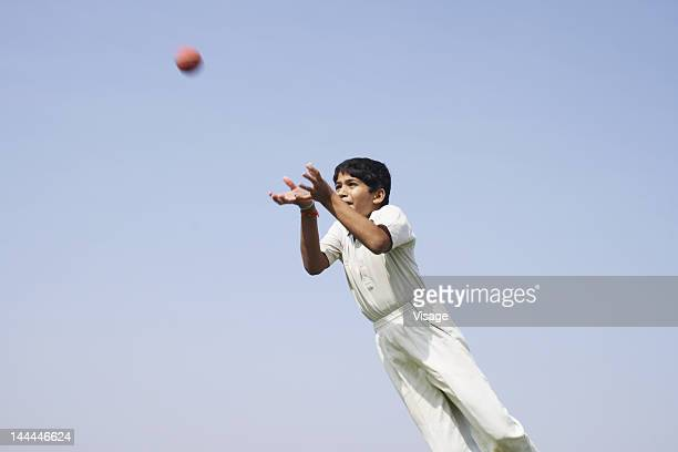 fielder diving for a catch - cricket player stock pictures, royalty-free photos & images