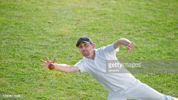 fielder diving on the field - cricket pitch stock pictures, royalty-free photos & images