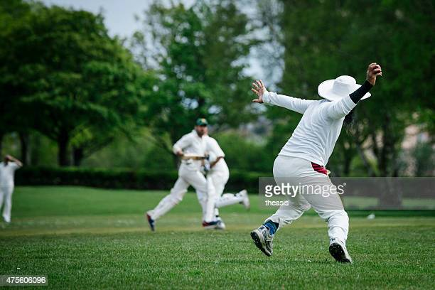 fielder throws the ball in a local club cricket match - theasis stock pictures, royalty-free photos & images