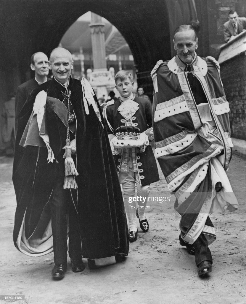 Field-Marshall Viscount Montgomery (L) and Sir Rupert de la Bere, Lord Mayor of London (R), leaving Westminster Abbey after the full dress rehearsal for the Coronation Ceremony, 29th May 1953. Nicholas Wright, page to Viscount Montgomery, is seen in the middle.