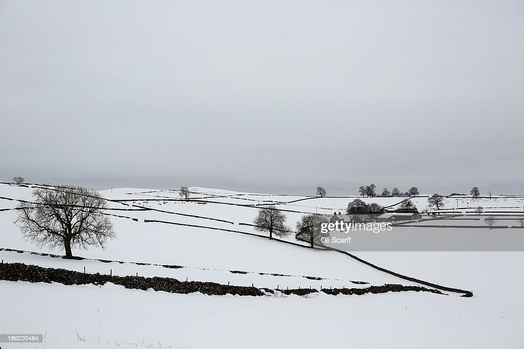 Fields are blanketed in deep snow near Dovedale in the Peak District on January 26, 2013 in Stanshope, England.