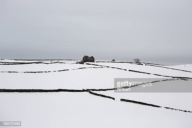 Fields are blanketed in deep snow near Dovedale in the Peak District on January 26 2013 in Stanshope England