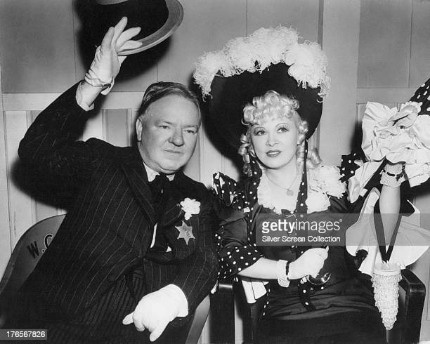 WC Fields as Cuthbert J Twillie and Mae West as Flower Belle Lee on the set of 'My Little Chickadee' directed by Edward F Cline 1940