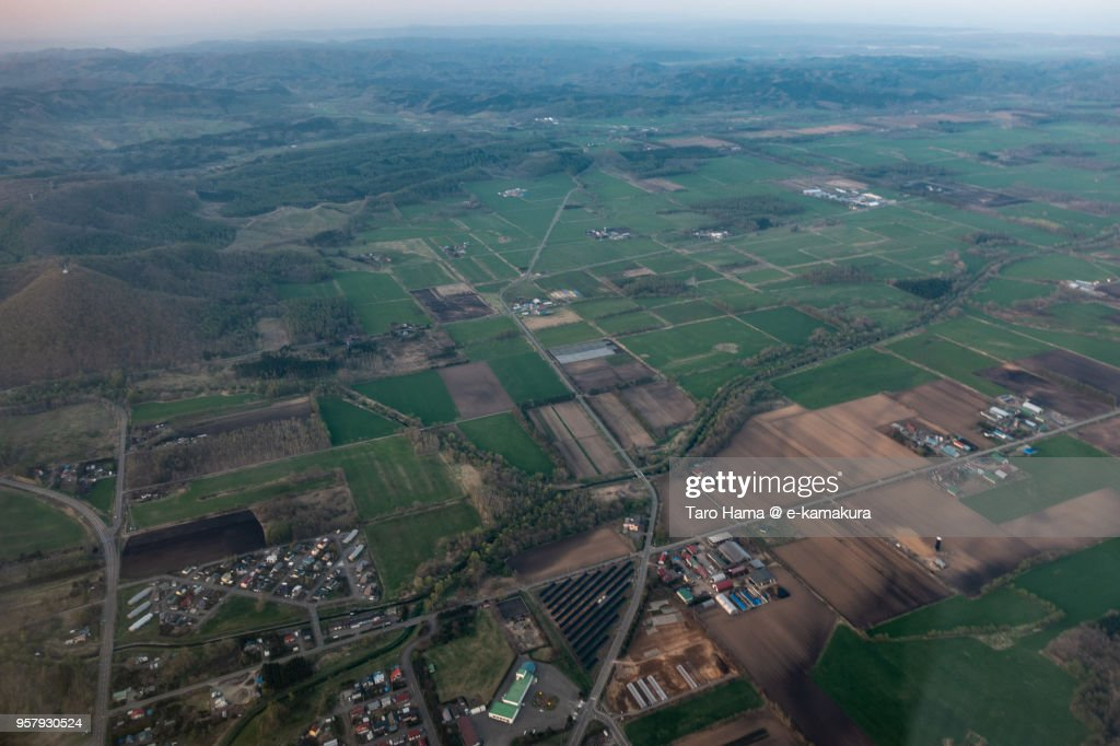Fields in Makubetsu town in Hokkaido in Japan aerial view from airplane : ストックフォト