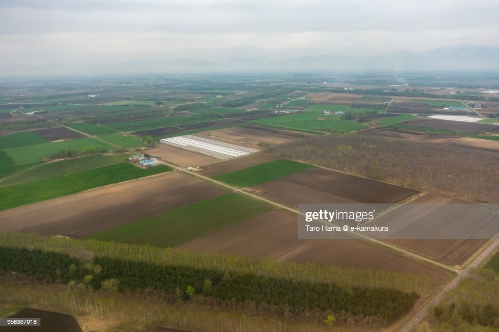 Fields in Nakasatsunai village in Hokkaido in Japan aerial view from airplane : ストックフォト