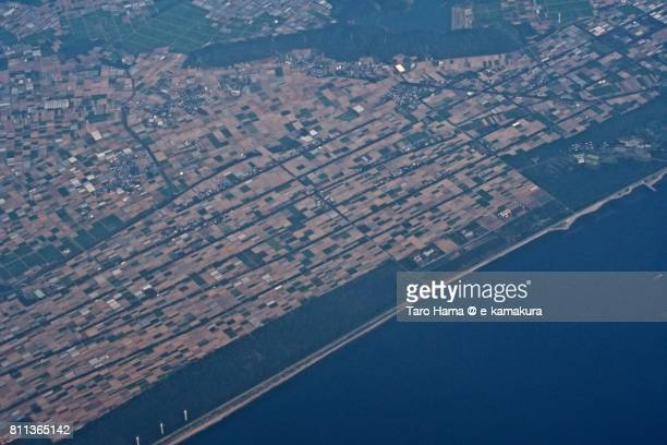 Fields in Tahara city in Aichi prefecture daytime aerial view from airplane