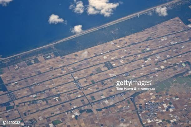 Fields in Tahara city in Aichi prefecture in Atsumi Peninsula daytime aerial view from airplane