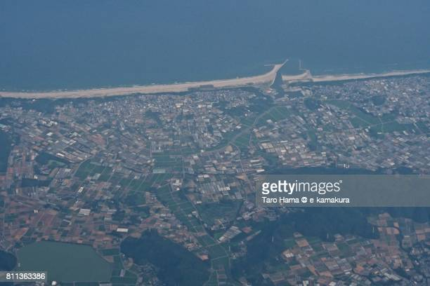 Fields in Tahara city in Aichi prefecture near Pacific Ocean beach daytime aerial view from airplane