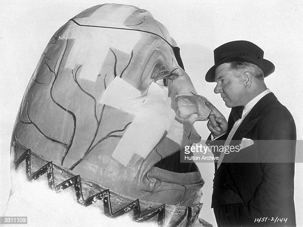Fields inspects his Humpty Dumpty costume from the Paramount film version of 'Alice in Wonderland'