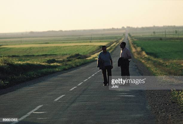 Fields of Fromista Two men walk observing the field on the road of Fromista Palencia province