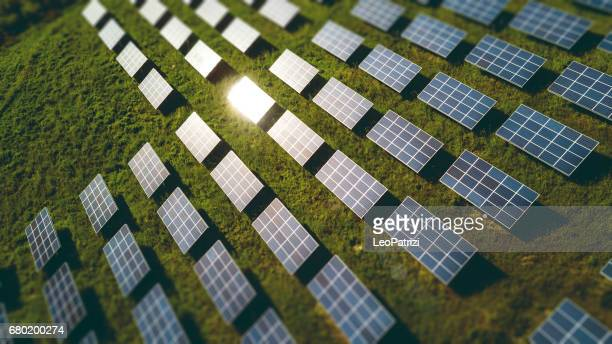 fields of solar panels on the green hills in spring - suns stock photos and pictures