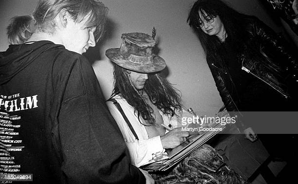 Fields of the Nephilim portrait backstage signing albums for fans United Kingdom 1990